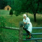 Farrell's grandmother climbing over the fence to see her school house